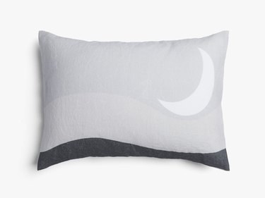 pillow with cover featuring a moon