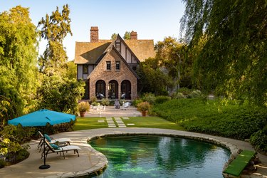 pool with view of tudor house