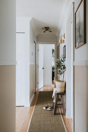 two tone narrow hallway with molding