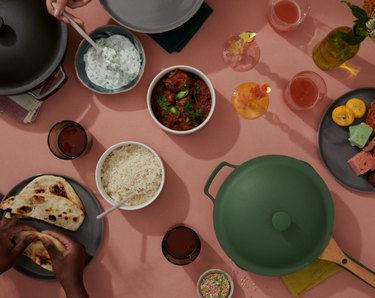 pans and food on pink background