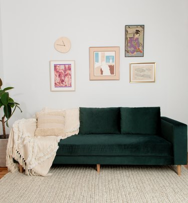 green velvet sofa with throw