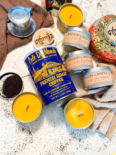 assorted candles in tin cans