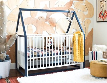 Crib with blue house frame