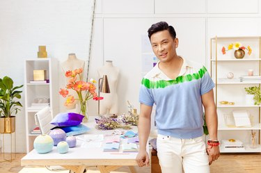 prabal gurung standing near a table with etsy wares