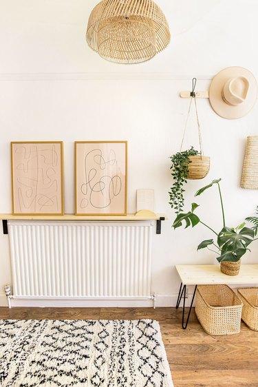 boho hallway with shelf over radiator and abstract artwork