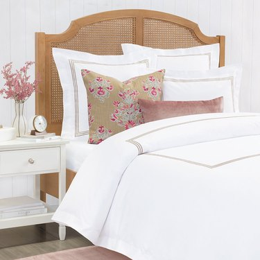 white bedding with accent pillows