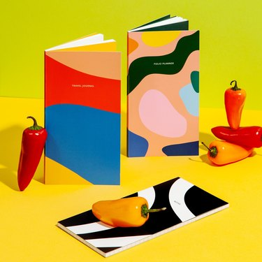 colorful journals with peppers on green and yellow background