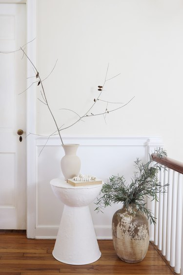 DIY plaster side table styled with vase and branches