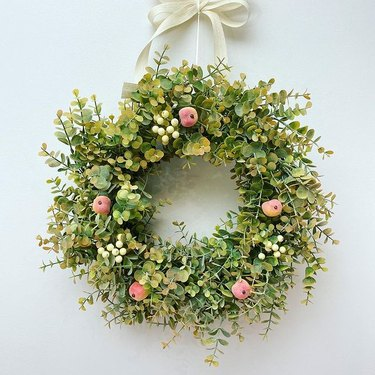 eucalyptus spring wreath with peaches and berries