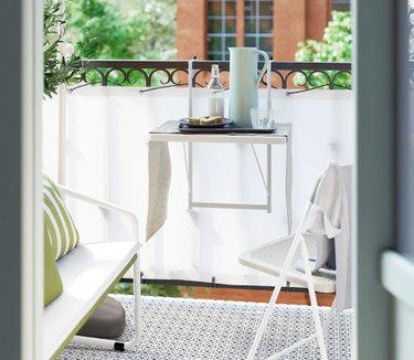 balcony with table and chair