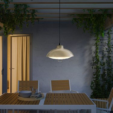 table with solar powered pendant lamp