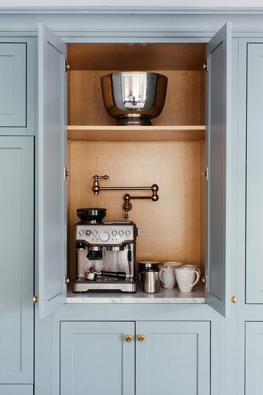 modern appliance garage with pot filler and stainless steel espresso machine