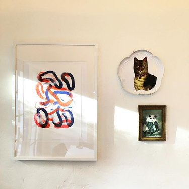 cat plate on wall with panda art