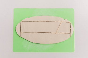 Cut out a ribbon-like shape using a toothpick or needle tool.