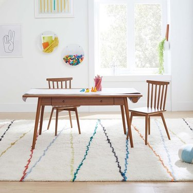 wood table and chairs in kids room