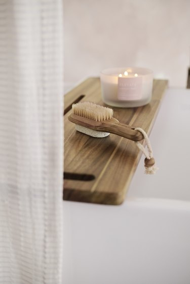 teak over the bath caddy and brush