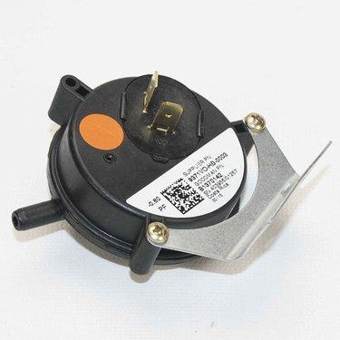 A close up of a pressure switch part