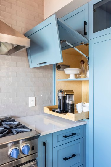 small appliance garage with folding door and pull out drawer
