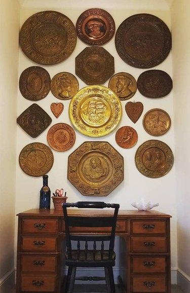 brass plate wall above wood desk