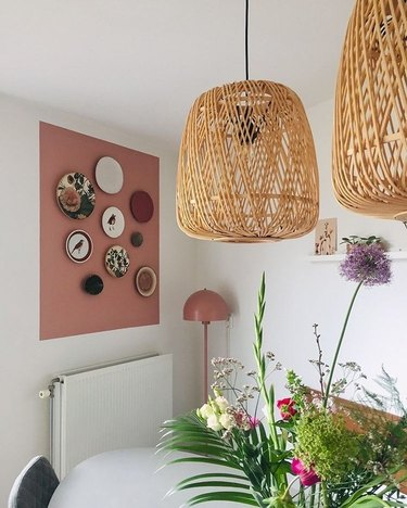 pink square painting on wall with plate art