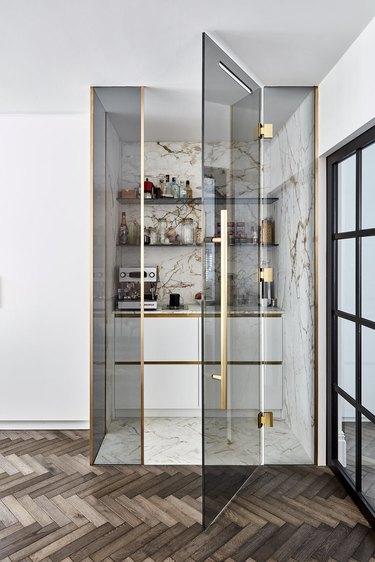 glass appliance garage with coffee machine