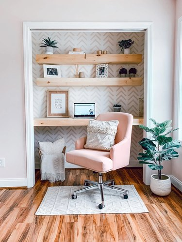 white and pink closet office with chevron wallpaper and pink office chair