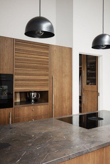 appliance garage in oak kitchen with tambour cupboard door