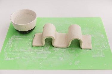 Turn the strip into a three-dimensional wave shape.