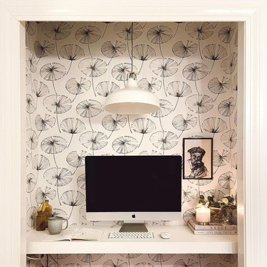 white closet office with white and black wallpaper