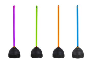 line of plungers with colorful handles