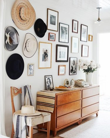 Farmhouse Chic Bedroom Ideas with Dresser with gallery wall, hats handing, chair