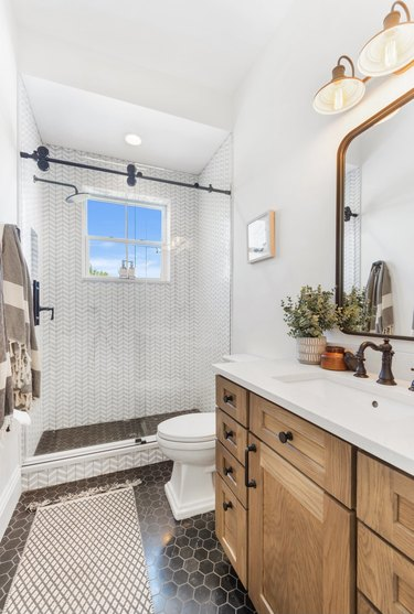 modern farmhouse bathroom with wooden vanity