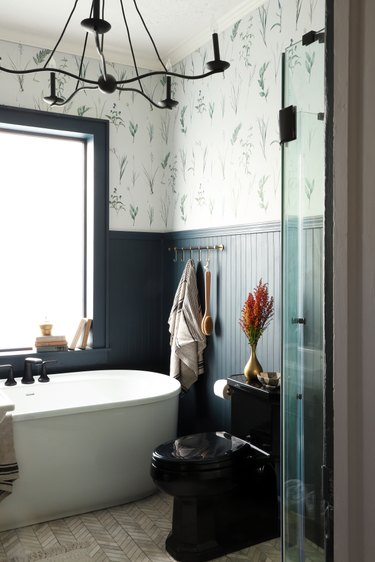 vintage farmhouse bathroom with blue shiplap walls and statement wallpaper