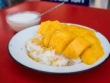 Eating Thai Food Khao Niew Mamuang (Mango Sticky Rice)