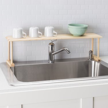 oak wood over  the sink storage shelf