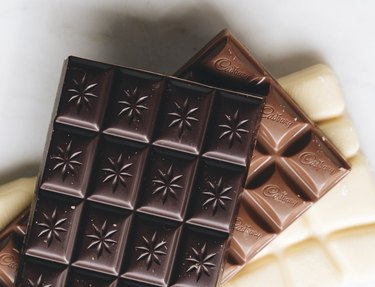 dark, milk, and white chocolate bar on white background