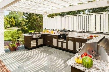 outdoor kitchen under white awningtrell