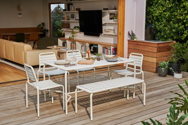 outdoor dining room with white furniture