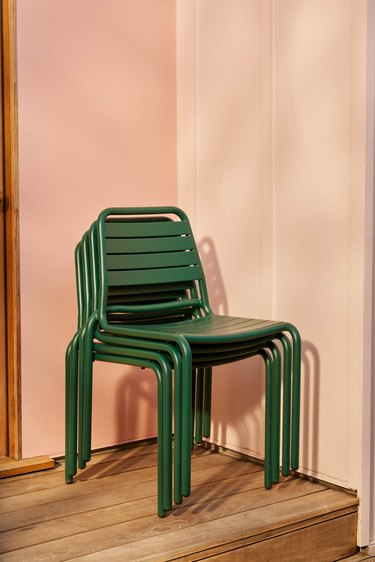 stacked green chairs