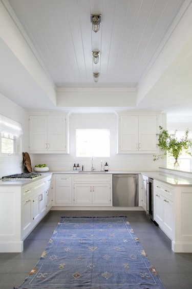 white kitchen with industrial caged flush mount light fixture