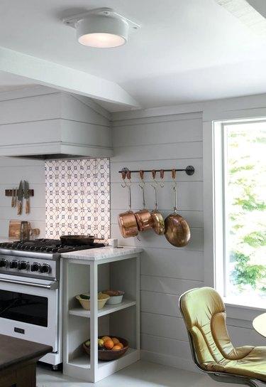 all white kitchen with sleek flush mount light fixture