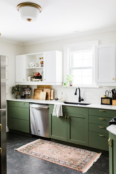 white and green kitchen with single flush mount light fixture
