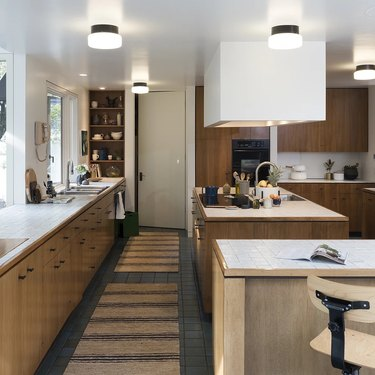 brown and white kitchen with frosted glass flush mount light fixtures