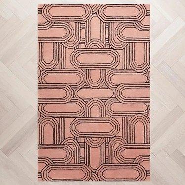 pink and black patterned rug
