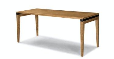 long oak Scandinavian desk on white background