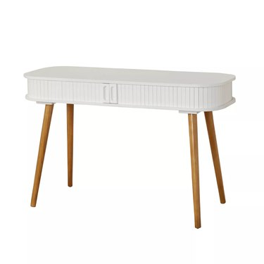 Scandinavian desk with wood legs and white paneled oval top