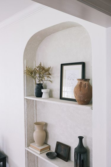 Built-in shelving area with Roman Clay finish