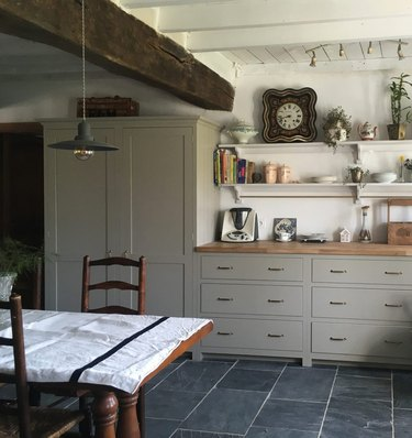 french country style kitchen with gray-green cabinets