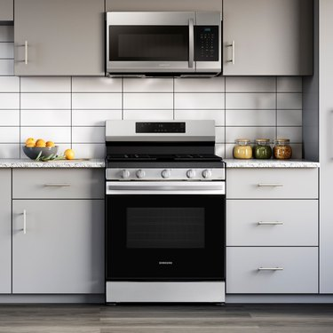 black and silver range in gray kitchen