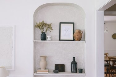 Built-in shelving area with Roman Clay on walls